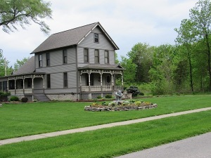 A victorian house with a great lawn ornament