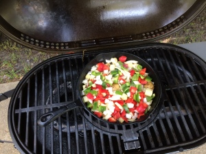 When the potatoes are almost done, add peppers (red and green) and onions. Add cooked bacon, it will help finish cooking the potatoes.