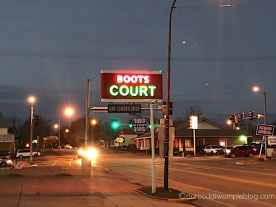 Boots Court at night